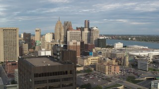 DX0002_196_039 - 5.7K stock footage aerial video view of a group of skyscrapers, descend to reveal office tower in Downtown Detroit, Michigan