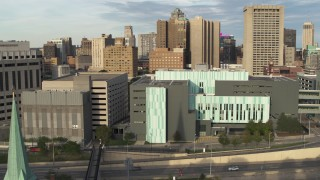 DX0002_196_043 - 5.7K stock footage aerial video of circling the Detroit Public Safety Headquarters in Downtown Detroit, Michigan