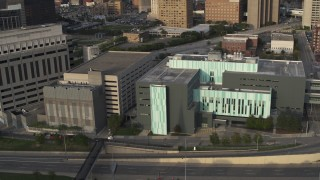 DX0002_196_045 - 5.7K stock footage aerial video descend while focused on the Detroit Public Safety Headquarters in Downtown Detroit, Michigan