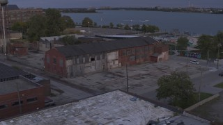 DX0002_197_009 - 5.7K stock footage aerial video of an orbit of an abandoned factory building at sunset, Detroit, Michigan