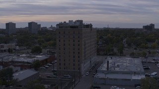 DX0002_197_020 - 5.7K stock footage aerial video of circling an apartment building at sunset, Detroit, Michigan