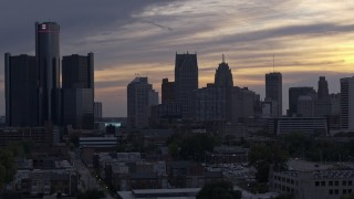 DX0002_197_026 - 5.7K stock footage aerial video of flying by the city's skyline at sunset, Downtown Detroit, Michigan