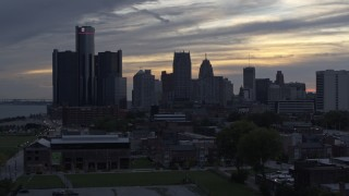 DX0002_197_031 - 5.7K stock footage aerial video focus on GM Renaissance Center and the city's skyline at sunset during ascent, Downtown Detroit, Michigan