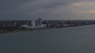 DX0002_197_044 - 5.7K stock footage aerial video of the city's skyline across the river at sunset, Windsor, Ontario, Canada
