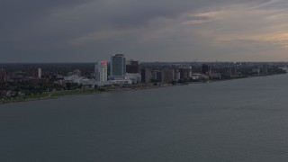 DX0002_197_045 - 5.7K stock footage aerial video of the city's skyline on the other side of the river at sunset, Windsor, Ontario, Canada
