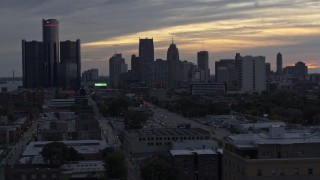 DX0002_197_048 - 5.7K stock footage aerial video of flying by the city's tall skyscrapers at sunset, Downtown Detroit, Michigan