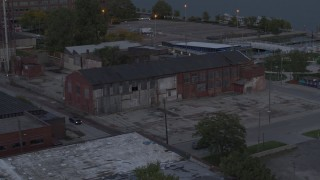 DX0002_197_049 - 5.7K stock footage aerial video of orbiting an abandoned brick building at sunset, Detroit, Michigan