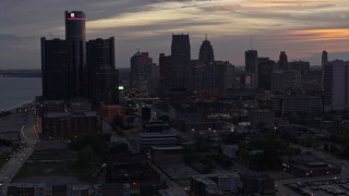 DX0002_198_004 - 5.7K stock footage aerial video of slowly flying away from the city's towering skyscrapers at sunset, Downtown Detroit, Michigan
