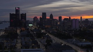 DX0002_198_010 - 5.7K stock footage aerial video of ascending past the city's towering skyscrapers at twilight, Downtown Detroit, Michigan