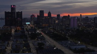 DX0002_198_013 - 5.7K stock footage aerial video of slowly passing the city's towering skyscrapers at twilight, Downtown Detroit, Michigan