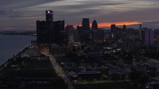 DX0002_198_014 - 5.7K stock footage aerial video of flying past the city's tall skyscrapers at twilight, Downtown Detroit, Michigan