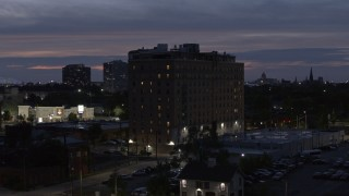 DX0002_198_023 - 5.7K stock footage aerial video of circling an apartment building at twilight, Detroit, Michigan