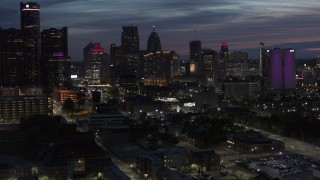 DX0002_198_026 - 5.7K stock footage aerial video of flying by and away from the city's skyline at twilight in Downtown Detroit, Michigan