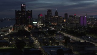 DX0002_198_028 - 5.7K stock footage aerial video of the city's skyline, seen from Jefferson Ave, at twilight in Downtown Detroit, Michigan