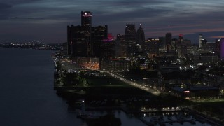 DX0002_198_029 - 5.7K stock footage aerial video of the city's skyline, seen from the river at twilight in Downtown Detroit, Michigan