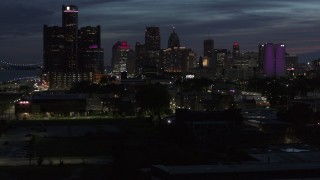 DX0002_198_031 - 5.7K stock footage aerial video of the city's skyline, seen during descent at twilight in Downtown Detroit, Michigan