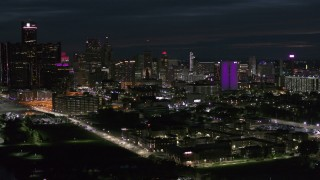 DX0002_198_036 - 5.7K stock footage aerial video of a view of the brightly lit city skyline at night, Downtown Detroit, Michigan