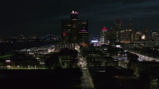 DX0002_198_041 - 5.7K stock footage aerial video focus on GM Renaissance Center during descent at night, Downtown Detroit, Michigan