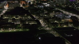 DX0002_198_051 - 5.7K stock footage aerial video of orbiting an apartment complex at night, Downtown Detroit, Michigan