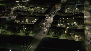 DX0002_198_052 - 5.7K stock footage aerial video approach and orbit Franklin Street and an apartment complex at night, Downtown Detroit, Michigan