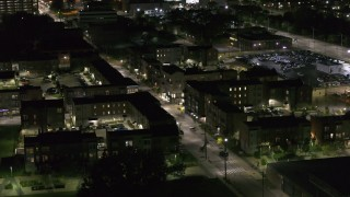 DX0002_198_054 - 5.7K stock footage aerial video of orbiting Franklin Street and an apartment complex at night, Downtown Detroit, Michigan