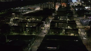 DX0002_198_055 - 5.7K stock footage aerial video of Franklin Street and an apartment complex at night, Downtown Detroit, Michigan