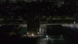 DX0002_198_056 - 5.7K stock footage aerial video of an apartment building at night, Detroit, Michigan