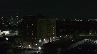 DX0002_198_059 - 5.7K stock footage aerial video of an orbit of an apartment building at night, Detroit, Michigan