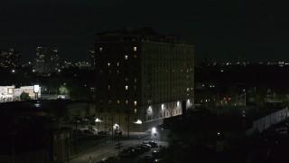 DX0002_198_063 - 5.7K stock footage aerial video approaching Pasadena Apartments at nighttime, Detroit, Michigan