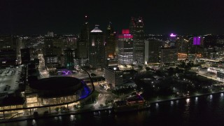 DX0002_199_006 - 5.7K stock footage aerial video static view of towering skyscrapers and Hart Plaza at night, Downtown Detroit, Michigan