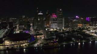 DX0002_199_007 - 5.7K stock footage aerial video of orbiting towering skyscrapers and Hart Plaza at night, Downtown Detroit, Michigan
