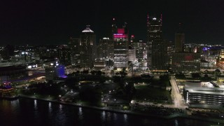 DX0002_199_008 - 5.7K stock footage aerial video orbit towering skyscrapers and Hart Plaza at night, Downtown Detroit, Michigan