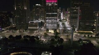 DX0002_199_015 - 5.7K stock footage aerial video Jefferson Avenue seen while descending to Hart Plaza at night, Downtown Detroit, Michigan