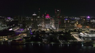 DX0002_199_020 - 5.7K stock footage aerial video of circling Hart Plaza and skyscrapers at night, seen from the river, Downtown Detroit, Michigan