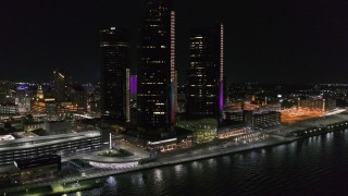 DX0002_199_027 - 5.7K stock footage aerial video of orbiting GM Renaissance Center by the river at night, Downtown Detroit, Michigan