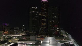 DX0002_199_030 - 5.7K stock footage aerial video focus on GM Renaissance Center during descent at night, Downtown Detroit, Michigan