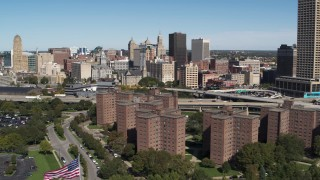 DX0002_200_002 - 5.7K stock footage aerial video ascend past apartment complex while focused on Downtown Buffalo, New York