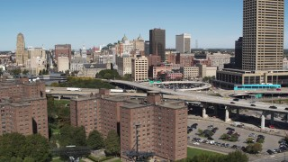 DX0002_200_007 - 5.7K stock footage aerial video flyby apartment buildings and skyline, reveal I-190, Downtown Buffalo, New York