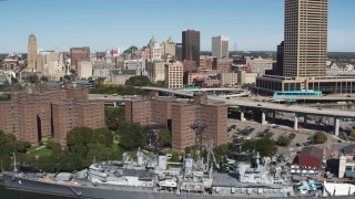 DX0002_200_009 - 5.7K stock footage aerial video flyby apartment buildings, skyline, and USS Little Rock, Downtown Buffalo, New York