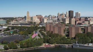 DX0002_200_013 - 5.7K stock footage aerial video ascend over apartment buildings to approach skyline, Downtown Buffalo, New York