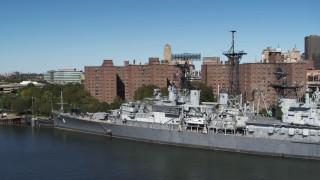 DX0002_200_018 - 5.7K stock footage aerial video orbit the USS Little Rock in Downtown Buffalo, New York