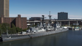 DX0002_200_019 - 5.7K stock footage aerial video orbit and approach the USS Little Rock in Downtown Buffalo, New York
