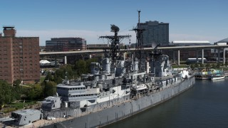 DX0002_200_020 - 5.7K stock footage aerial video close orbit of the USS Little Rock in Downtown Buffalo, New York