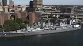 DX0002_200_021 - 5.7K stock footage aerial video of a reverse view of the USS Little Rock in Downtown Buffalo, New York