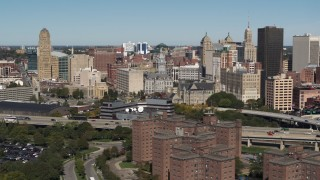DX0002_201_001 - 5.7K stock footage aerial video focus on County and City Hall. in the city's skyline, Downtown Buffalo, New York