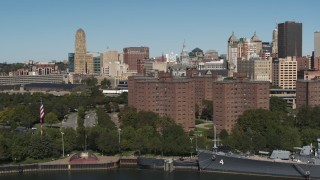 DX0002_201_006 - 5.7K stock footage aerial video orbit Marine Drive Apartments and reveal skyline, Downtown Buffalo, New York