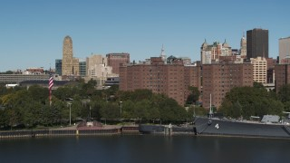 DX0002_201_007 - 5.7K stock footage aerial video descend by river near Marine Drive Apartments, Downtown Buffalo, New York