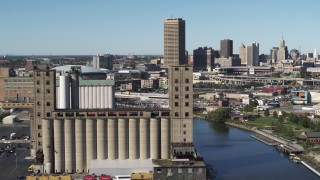DX0002_201_021 - 5.7K stock footage aerial video ascend and orbit a grain elevator in Buffalo, New York