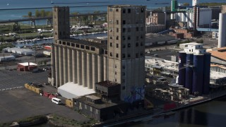 DX0002_201_022 - 5.7K stock footage aerial video orbit a riverfront grain elevator in Buffalo, New York