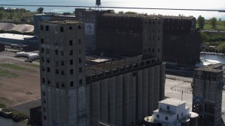 DX0002_201_023 - 5.7K stock footage aerial video circling a large grain elevator in Buffalo, New York